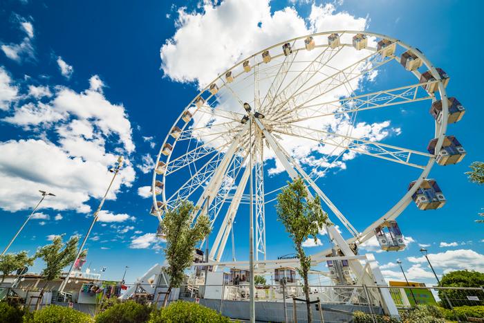 Rimini Ferris wheel over the canal port, in Rimini, Italy shutterstock_432326140.jpg