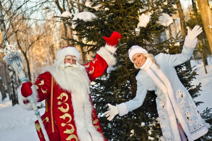 Russian Christmas characters Ded Moroz (Father Frost) and Snegurochka (Snow Maiden) with gifts bag shutterstock_120397105.jpg